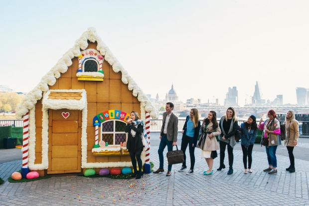 1. Commuters queue for a bite of Giant Gingerbread House - Shrek's Adventure! London.JPG-pwrt2